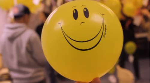 A yellow ballon with a smiling face that students handed out Project Happy Power.