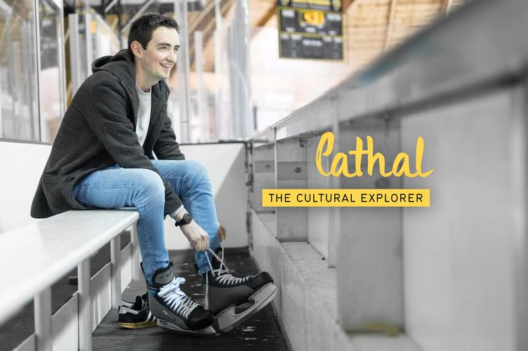 Cathal lacing up his skates.