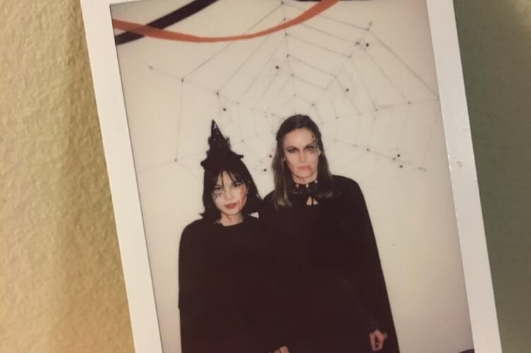 Si Yon and her friend dress up as witches for a Halloween Party.
