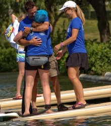 Madeline embracing On Board participant