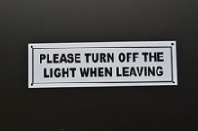 """Please turn off the light when leaving"" sign."