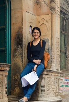 Kanika poses in front of crumbling facade