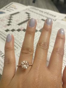 Engagement ring and crossword puzzle.