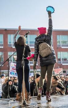 Sarah Wiley turned from the camera, leading the crowd at the Women's March