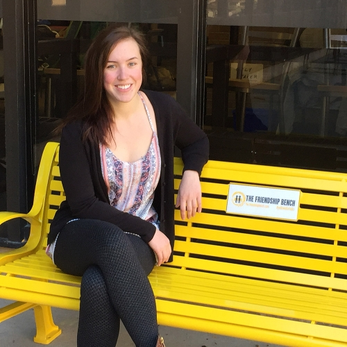 Hannah in front of UWaterloo's new Friendship Bench