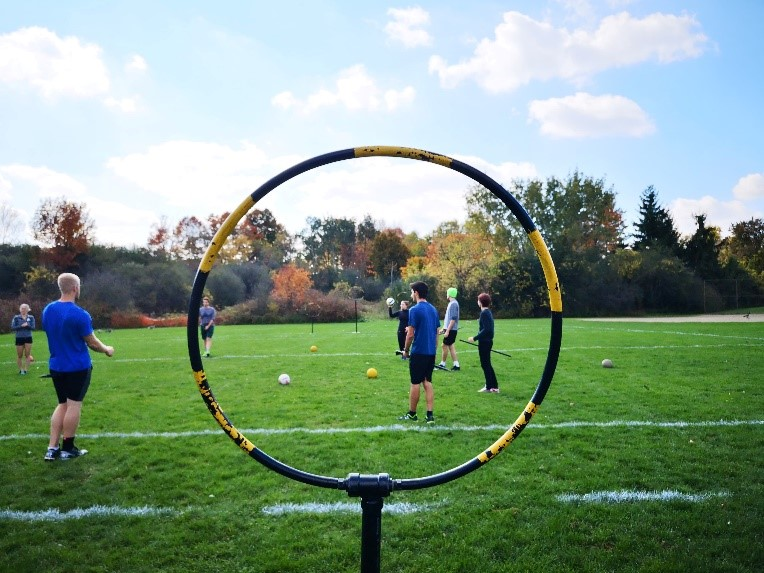 Photo of one hoop and quidditch players practicing.