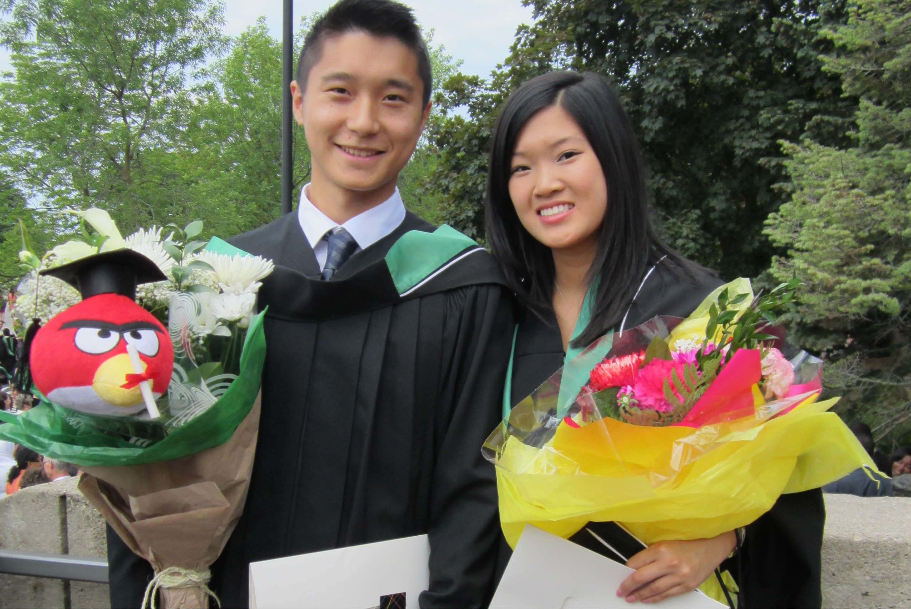 Justin and Daphne in their graduation gowns, on their Convocation Day