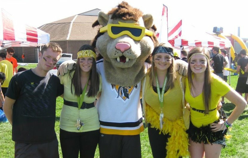 Brittany with friends and school mascot.
