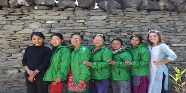 Courtney poses for a photo with a group of Nepalese women.