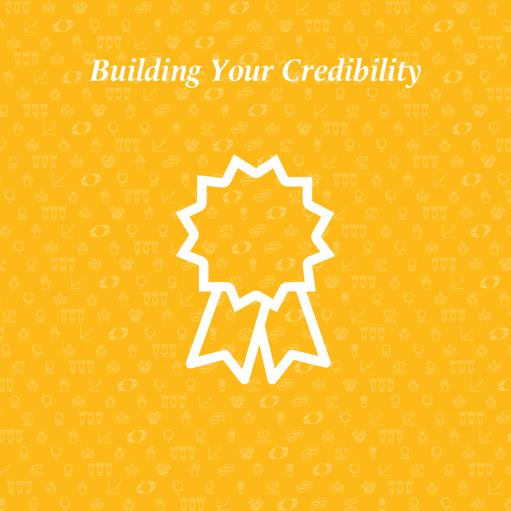 building your credibility written above a medal