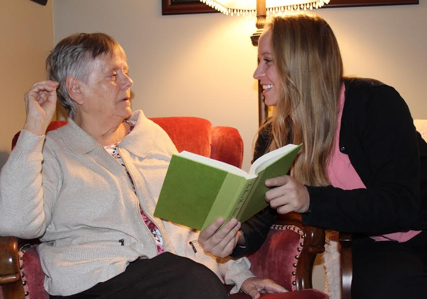 Rachel reading to her grandmother