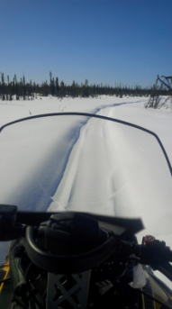 Point of view snowmobile ride in northern Canada