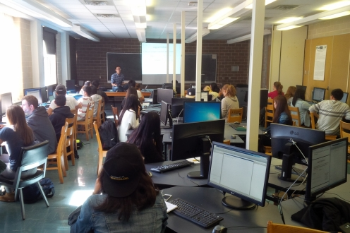 Matlab workshop filled with students on computers with Fred instructing