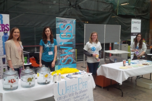 Two SWIGS booths side by side with volunteers at World Water Day