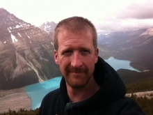 Philip DeWitt profile picture with mountainous background