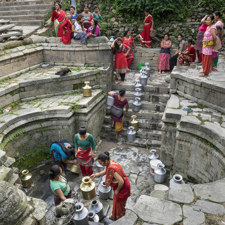 """Queuing for Water"" by Joe B N Leung. Women wait in long lines for water in a village near the Changu Narayan Temple, north of B"