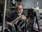 a female student performs lab work in the Institute of Quantum Computing at the University of Waterloo