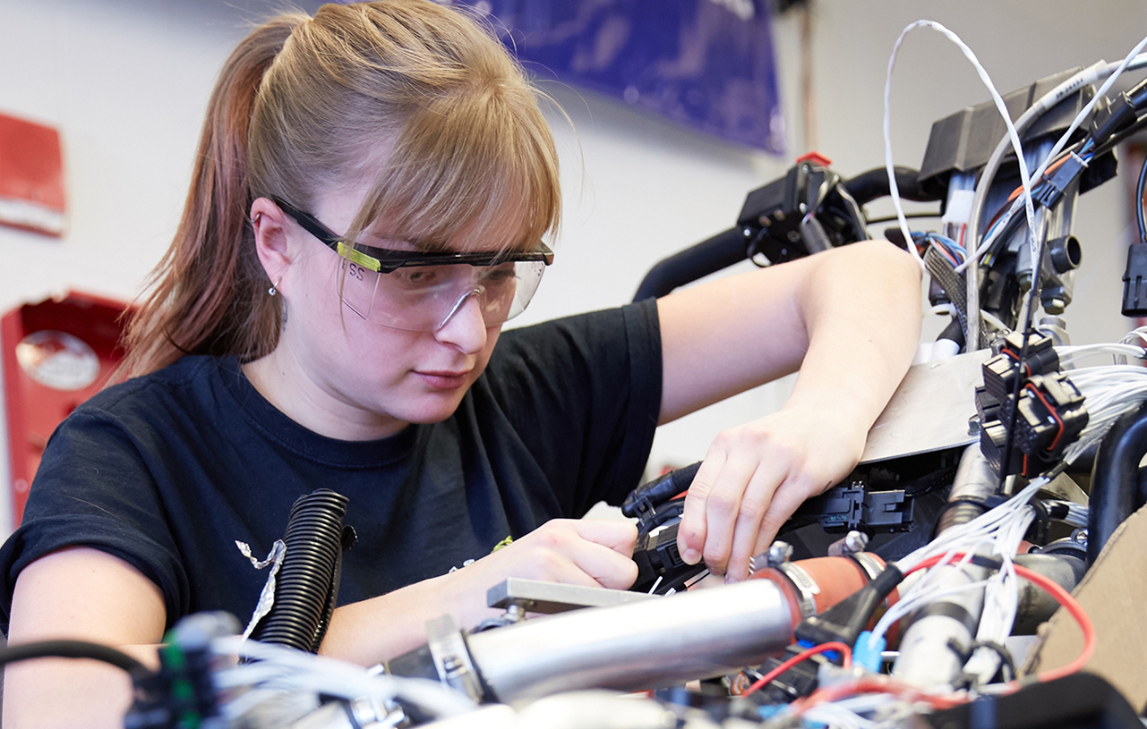 a female engineering student works on a project