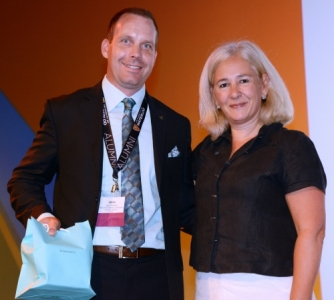 Jason Coolman accepts his award from CASE president Sue Cunningham
