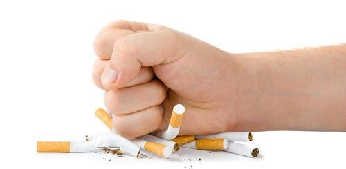 fist crushing cigarettes