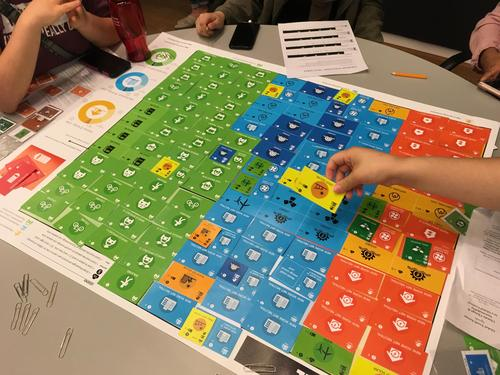 Two students playing Energize board game