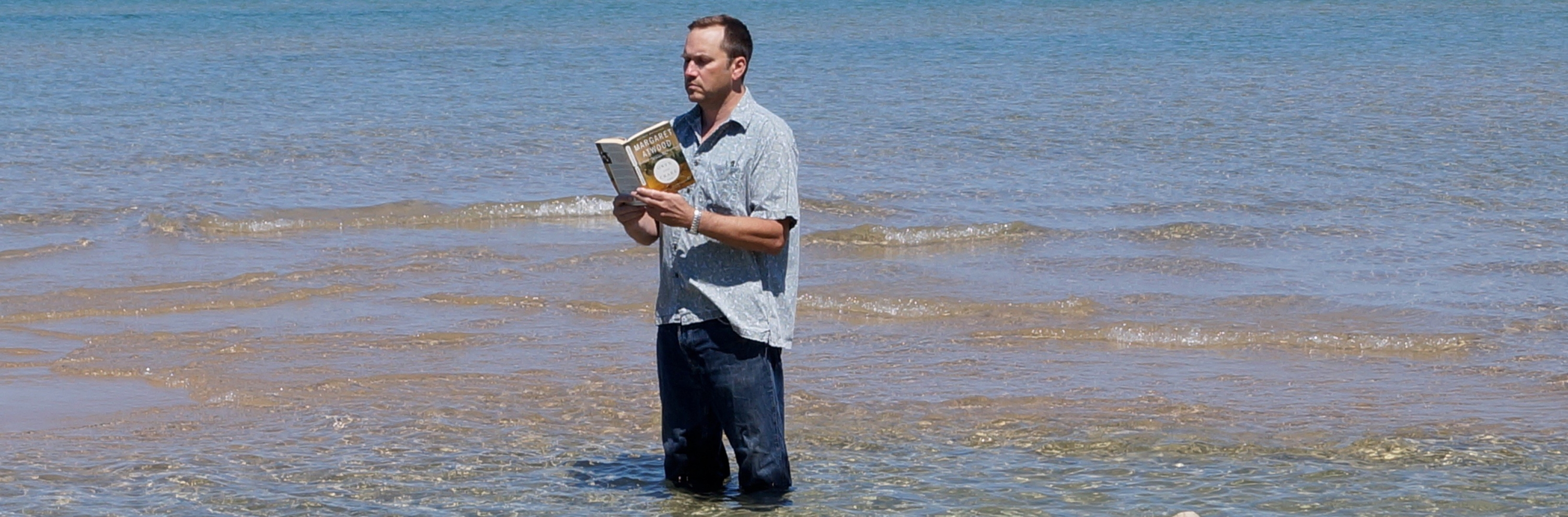 Professor McMurry reading a book in the water