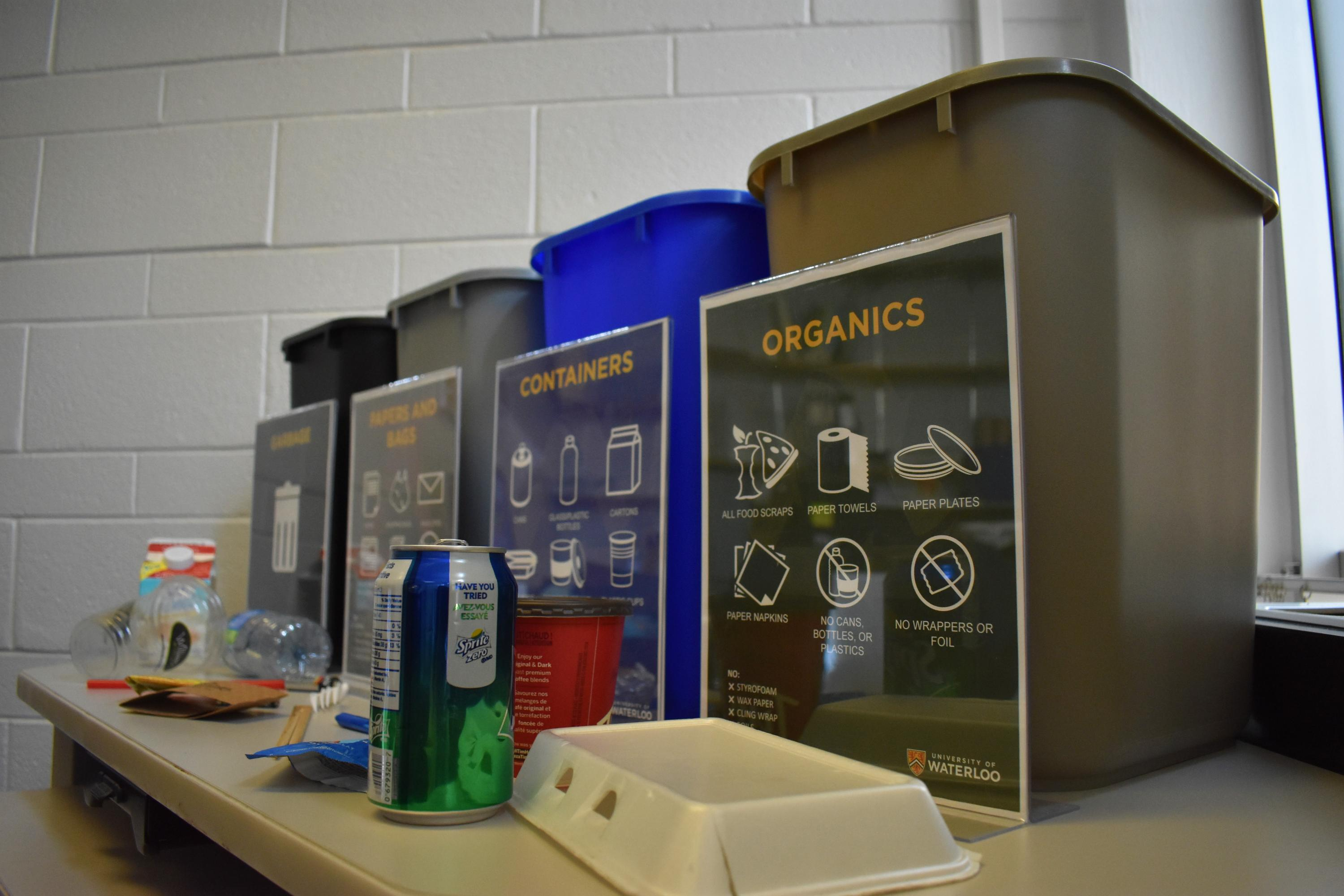 4 waste bins with garbage items to be sorted