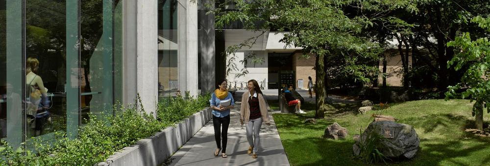 2 students walking outside STC