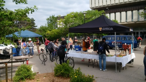 Students and staff receiving free tune-ups and food at Bike-to-Work Breakfast
