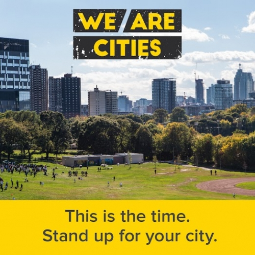 Urban landscape with We Are Cities logo