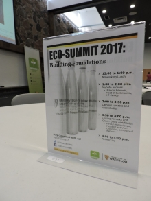 Eco-Summit poster on the table that outlines the day's agenda