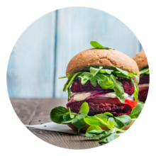 Plant-based burger with leafy greens on a bun