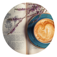 Book with some dried lavender and a cappucino with a heart on top