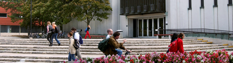 Arts Lecture Hall with students walking in front
