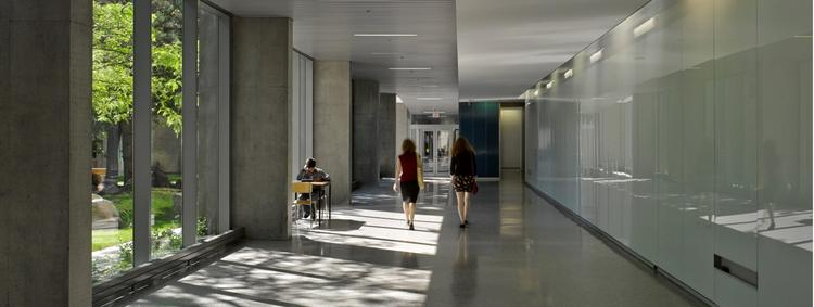 Employees walking down hall of Quantum Nano Centre