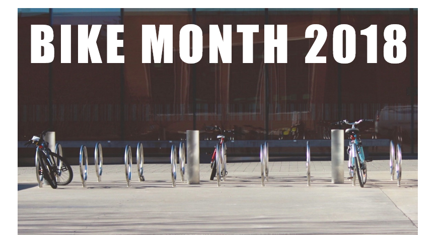 Bike Month 2018 with row of bike racks and bikes in front of DP library