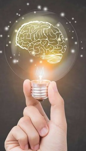 Hand holding a light bulb with glowing brain inside