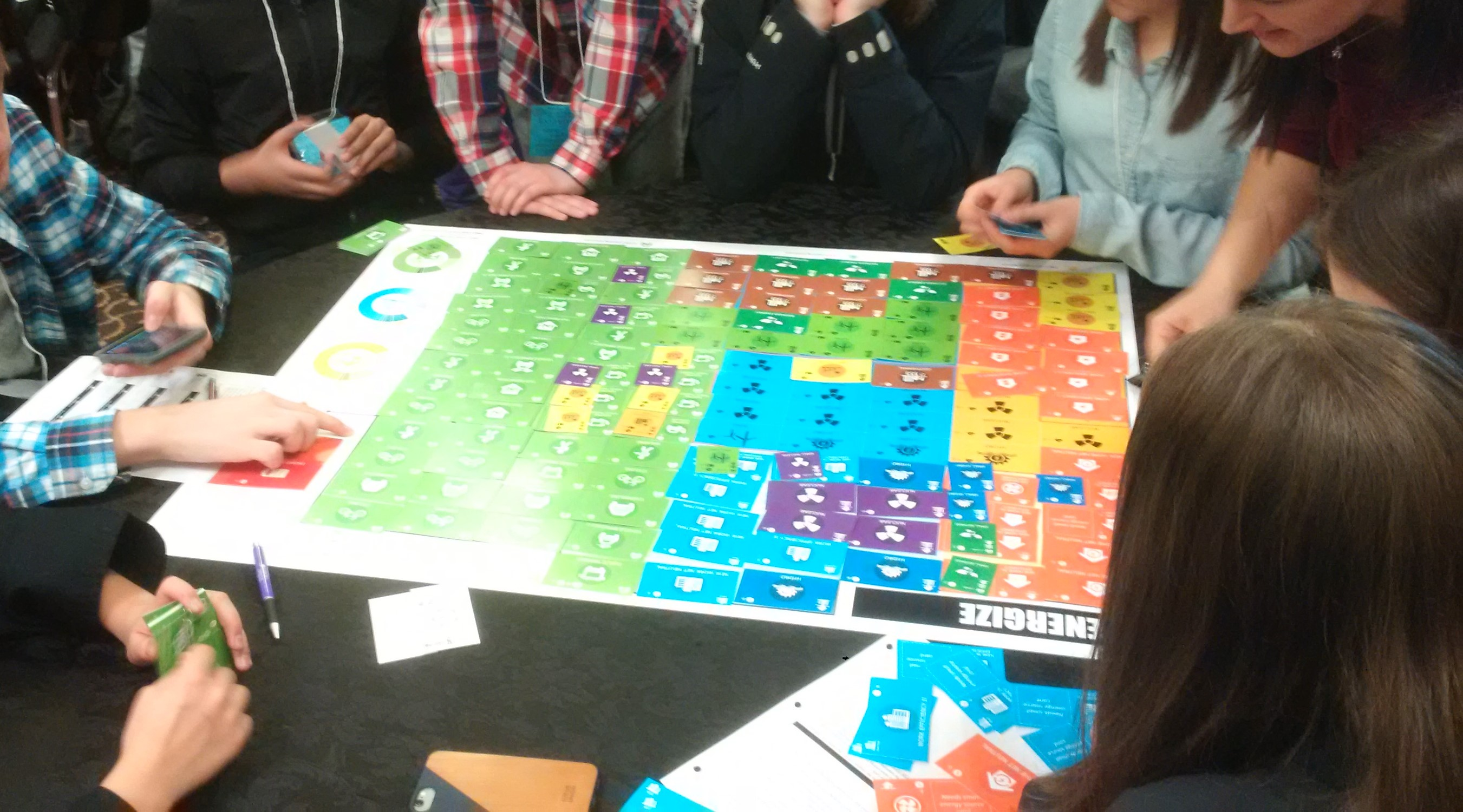 Students playing the Energize: Sustainable City Challenge board game