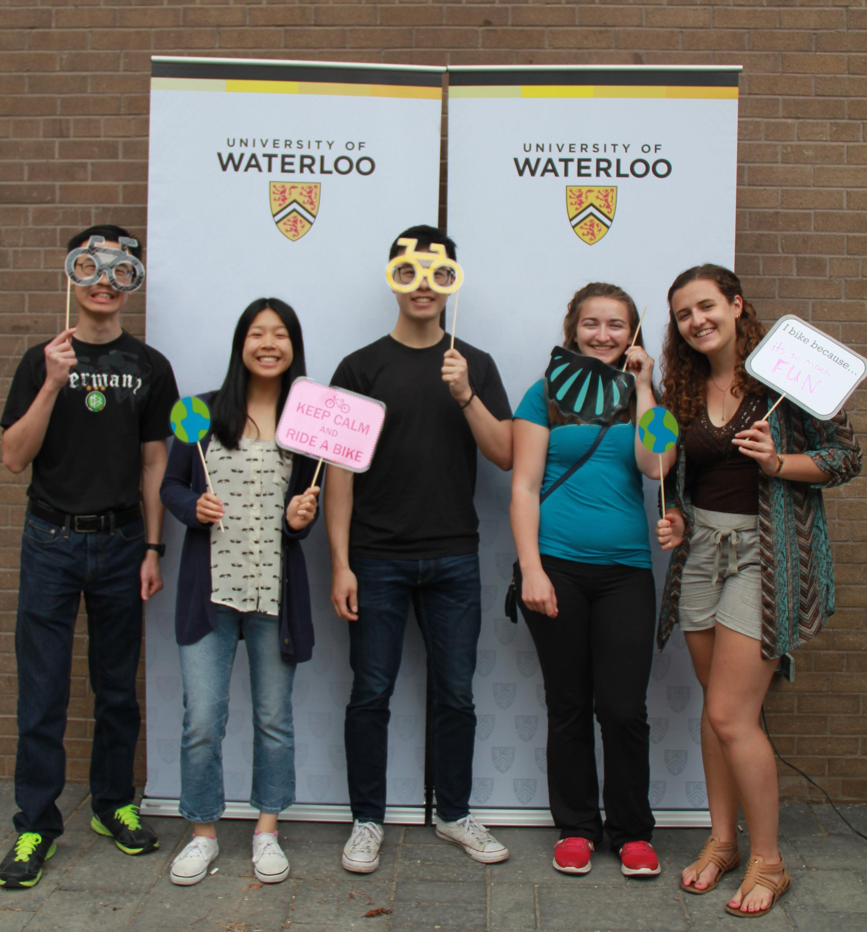 5 students in front of a photobooth with props at Bike Lunch