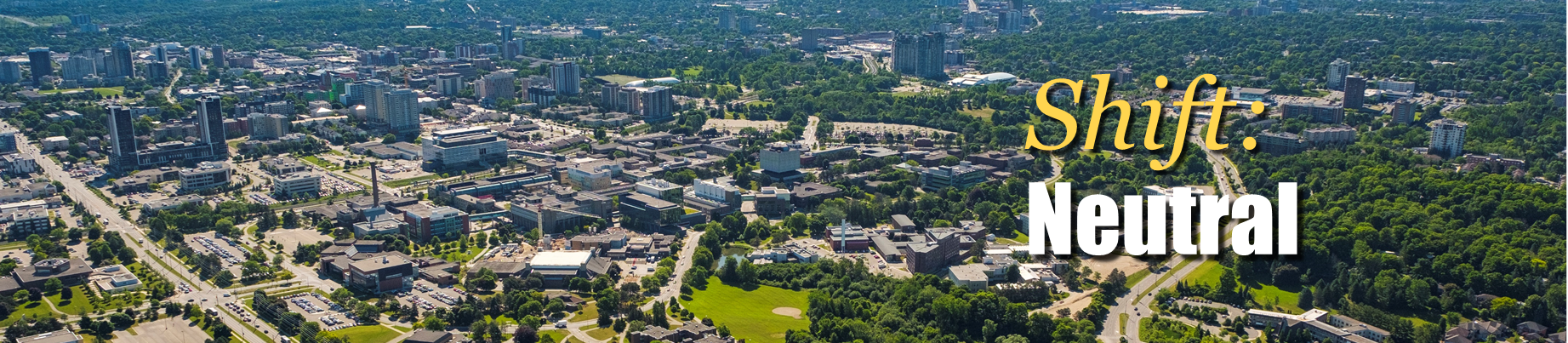 Aerial view of campus with Shift: Neutral text