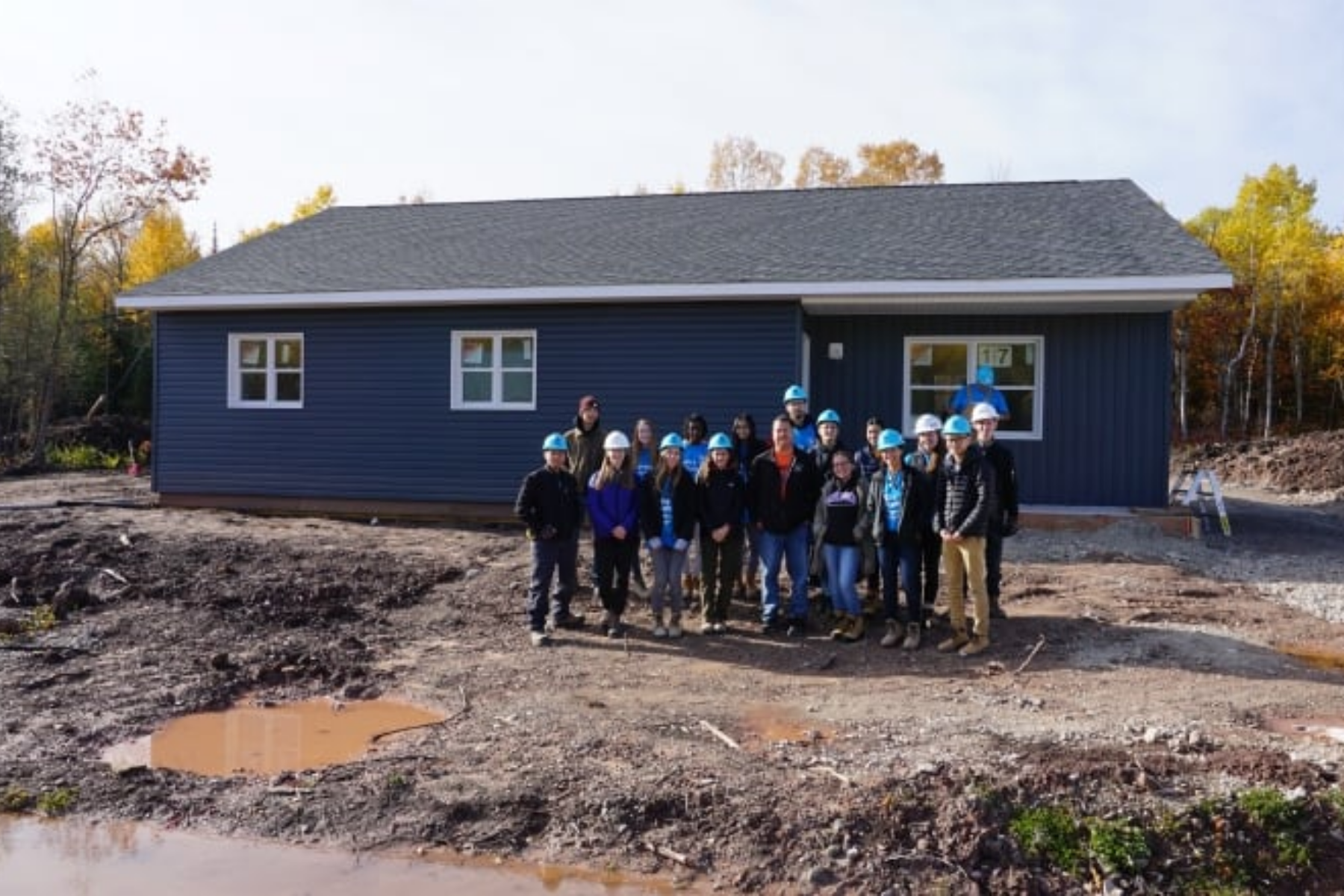 Warrior Home team in front of their completed home