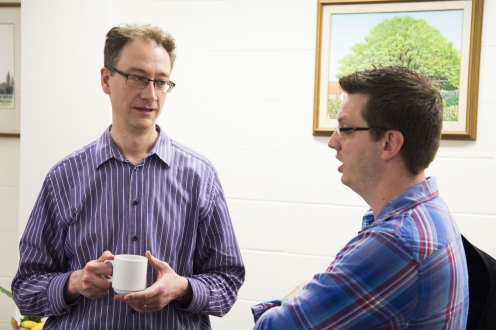 Faculty member and student in conversation.