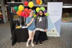 Two peer educators at a Thrive booth