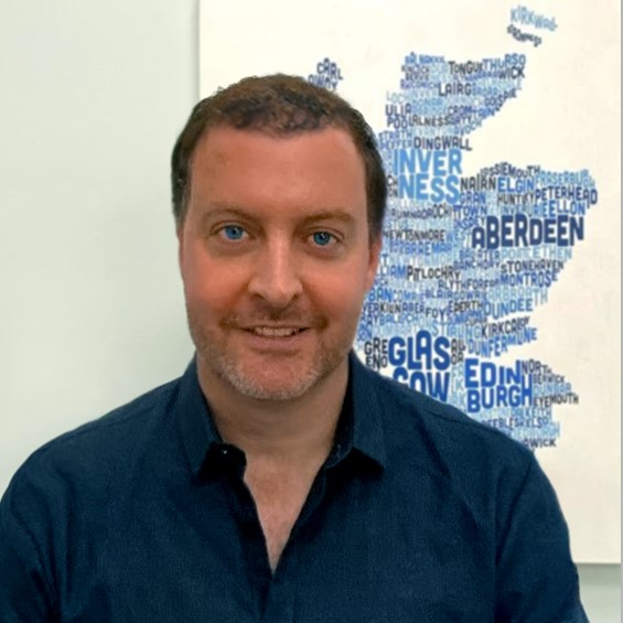 James Fraser head shot in front of blue wordle map of Scotland