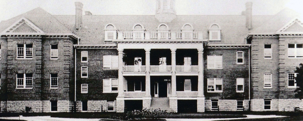 old black and white photo of large brick school building