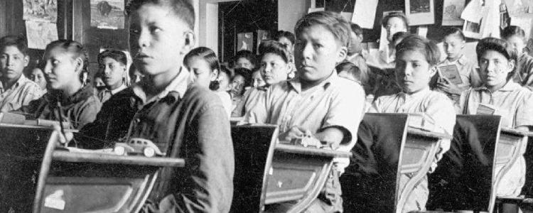 Old photo of Aboriginal children in classroom.