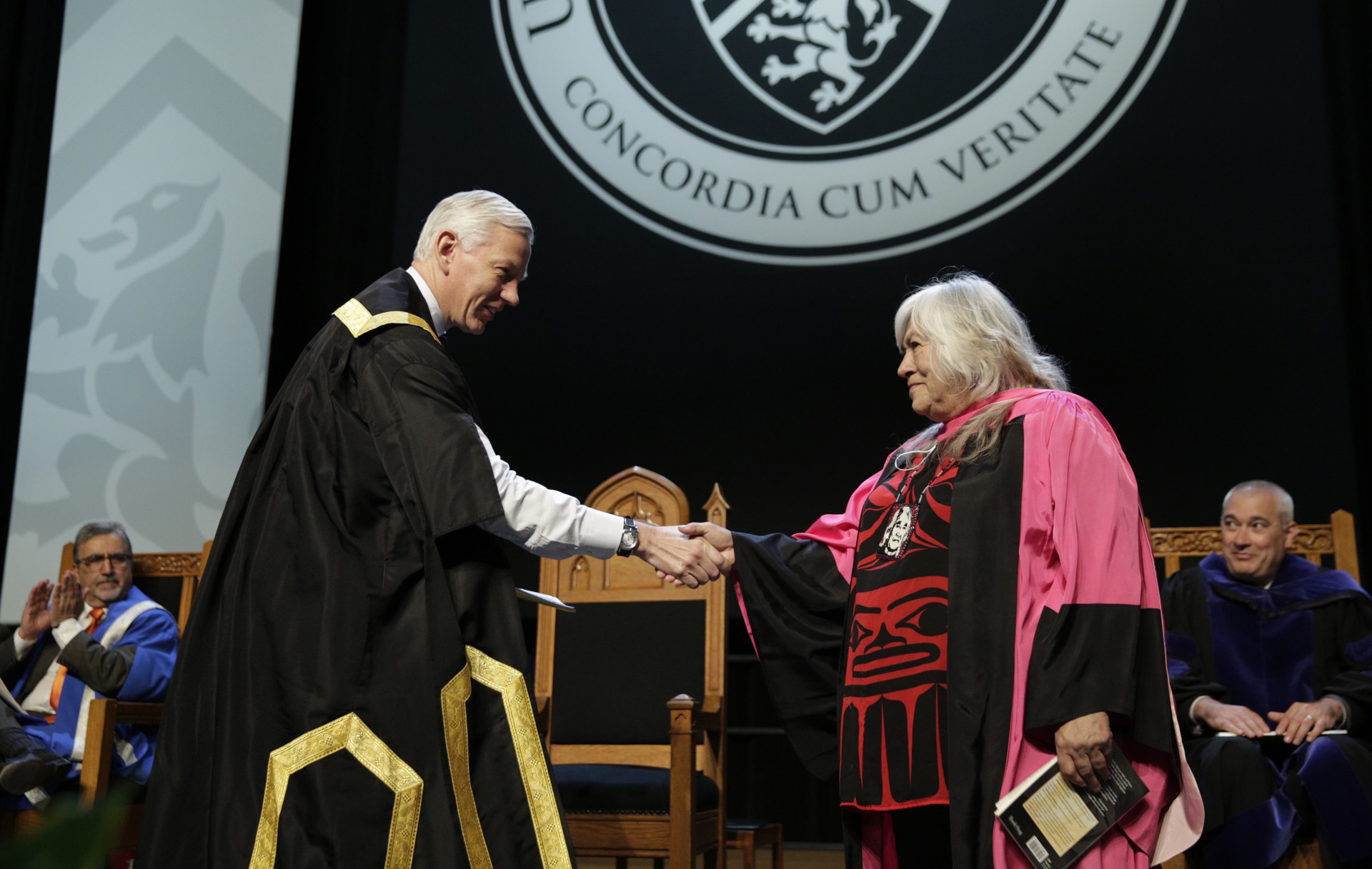 Waterloo Chancellor shaking hands with Lee Maracle at convocation ceremony