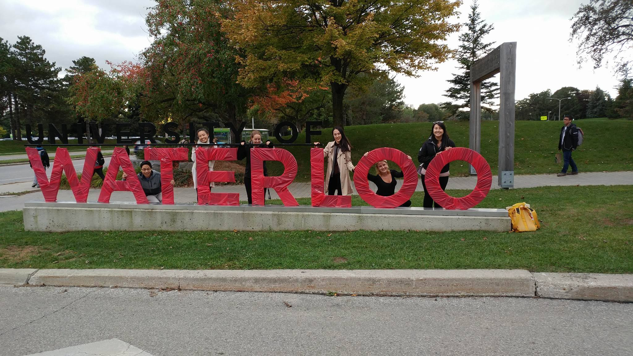 University of Waterloo entrance sign wrapped in red tape for Go Red day
