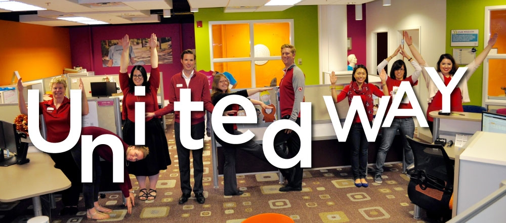 Staff members pose as letters that spell out United Way