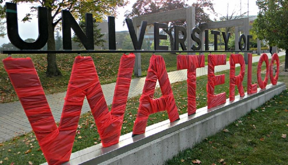 University of Waterloo sign painted red for 'Goes Red' day